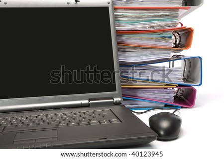 Isolated stack of folders with laptop computer shot over white background - stock photo