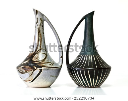 Israeli ceramic pair  Black grey brown tones Two vases of 1950-th years. Unusual forms  Glazed surfaces  Abstract drawing  Symbolizes couple: He - She  Brother - sister  Bride - groom etc  On white - stock photo