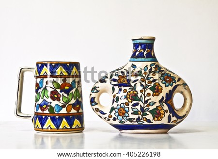 Israeli colorful ceramic pair of 1950-th years. Unusual forms, glazed surfaces, floral and geometric ornament. Symbolizes couple: He - She; brother - sister, bride - groom etc. Isolated on white. - stock photo