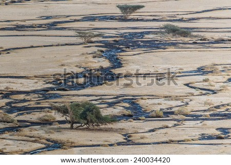 2014 Israeli oil Spill In December 2014, an oil spill occurred near Eilat, Israel, with  3-5 million liters of crude oil leaking from a breached pipeline, contaminating the Evrona nature reserve. - stock photo