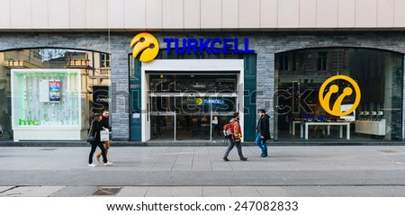 ISTANBUL, TURKEY - JANUARY 20: Pedestrians walk past an Turkcell mobile telephone retail in stiklal street, Turkey, January 20, 2015.