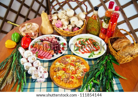 Italian cuisine  still life cooking ingredients and dishes - stock photo