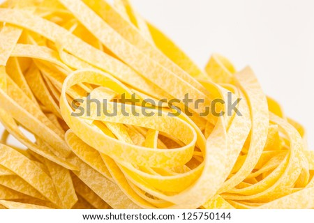 Italian pasta Tagliatelle isolated on white, with space for text