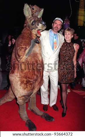 """16JAN97:  Actor JOHN CLEESE & wife ALYCE FAYE at the World Premiere of his new movie, """"Fierce Creatures,"""" in which he stars with Jamie Lee Curtis  & Kevin Kline.  Pix: PAUL SMITH - stock photo"""