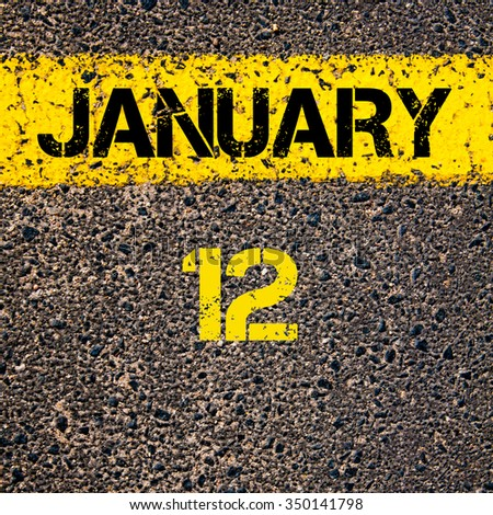 12 January calendar day written over road marking yellow paint line - stock photo