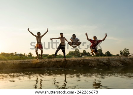 01 january 2015; group of happy asia young people jumping  at the beach on beautiful summer sunset,bangkok thailand - stock photo