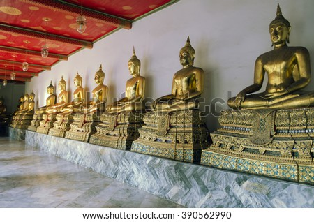 20 January, 2016 - Wat Pho buddhist temple, Bangkok, Thailand: A row of golden Buddha statues in Wat Pho cloister - stock photo