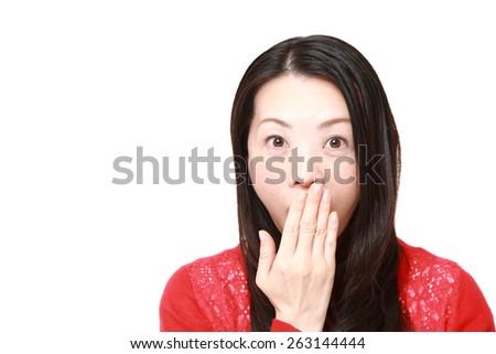 Japanese woman surprised - stock photo