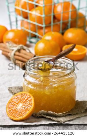 jar with tangerine jam on a linen napkin - stock photo