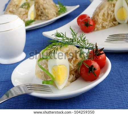 Jellied chicken decorated with egg and dill