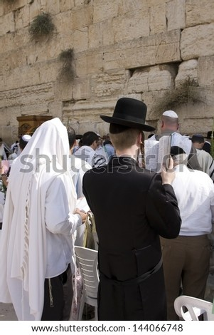 JERUSALEM-OCTOBER 02: The Jews  at the Western Wall during Jewish holiday of Sukkot, October 2, 2012 in Jerusalem, Israel.