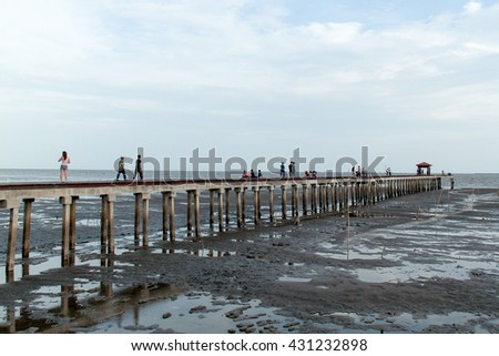 jetty pier while low tide at evening Thailand .