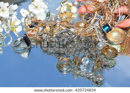 jewelry and hand, reflection in pure water