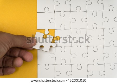 jigsaw puzzle add last one to completed - stock photo