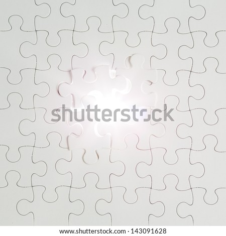 jigsaw puzzle pieces against the light - stock photo