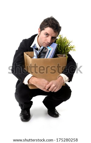 Jobless young Business Man in messy Suit and Necktie carrying Cardboard Box with office belongings Fired from Job isolated on White Background looking depressed, sad an in stress - stock photo