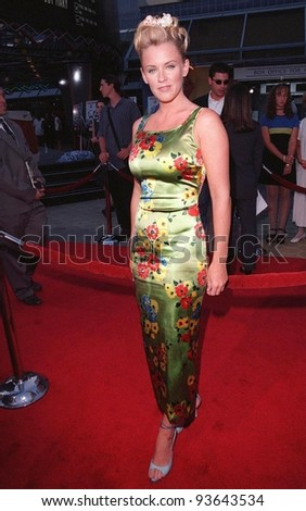 "28JUL98: Actress/presenter JENNY McCARTHY at the premiere of ""BASEketball"" at Universal Studios. She stars in the movie with Yasmine Bleeth, Trey Parker & Matt Stone. - stock photo"