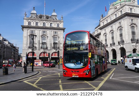 29 July, 2014 - London, England : The big red bus is an iconic image of London, England, and a big tourist attraction.
