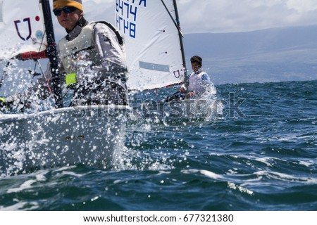 23 July 2015, Young sailors from around the World compete at the 2015 European Optimist Sailing Championships, held at the Welsh National Sailing Centre, Plas Heli, Wales.