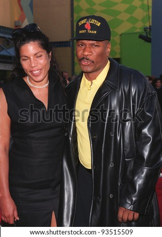 "17JUN98:  Actor VING RHAMES & wife at premiere of his new movie ""Out of Sight,"" in which he stars with George Clooney, at Universal Studios, Hollywood."