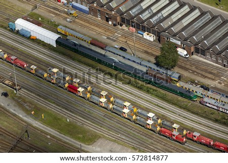 4 June 2015, Amersfoort, Netherlands. Aerial view of marshalling railway station with new locomotives and old wagons and a old station building.