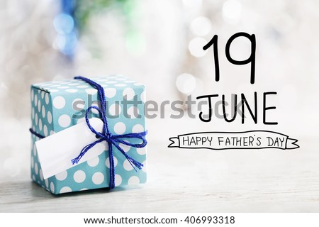 19 June Happy Fathers Day message with small handmade gift box  - stock photo