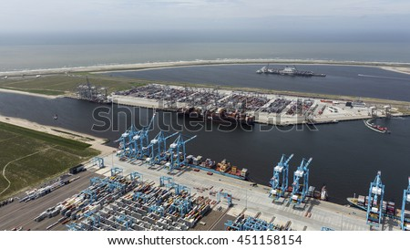 29 June 2016, Rotterdam, Holland. Aerial view of APM terminal with blue cranes in the harbor TWEEDE MAASVLAKTE, Netherlands.