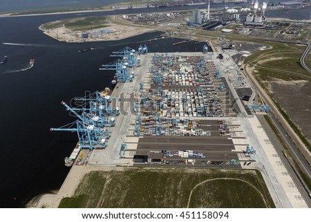 29 June 2016, Rotterdam, Holland. Aerial view of brand new container terminal with large blue cranes in the harbor TWEEDE MAASVLAKTE, Netherlands.