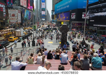 2 June 2016- Tourists and locals enjoy summer weather on the steps of Times Square, New York