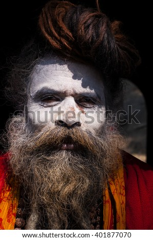 KATHMANDU, NEPAL - FEB 02: unidentified Sadhu at Pashupatinath Temple on February 02, 2014, Kathmandu, Nepal. The two primary sectarian divisions in sadhu community are Shaiva and Vaishnava.