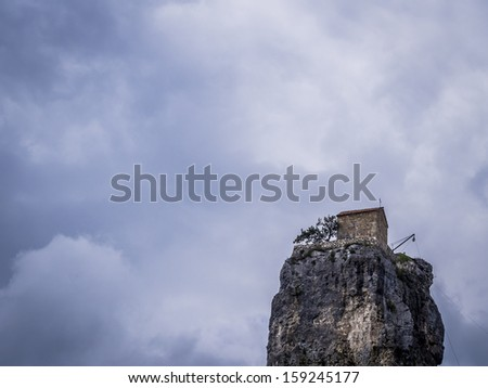 Katskhi pillar church in Georgia. Katskhi pillar is a small church constructed on a 40m high limestone pillar, what makes it one of the strangest attractions of Georgia.