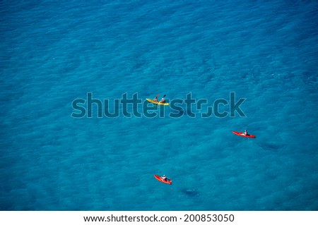 Kayakers floating on the sea. Tyrrhenian Sea, region of Calabria, Italy. Vacationers.