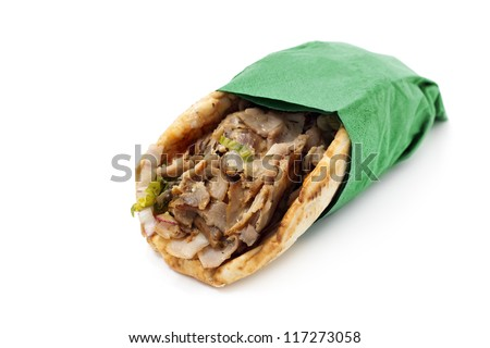 kebab wrapped in a green napkin isolated on white background - stock photo