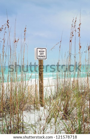 """""""Keep Off Dunes"""" sign at Pensacola beaches highlights ecosystem restoration efforts in the wake of yearly hurricanes and storms. - stock photo"""