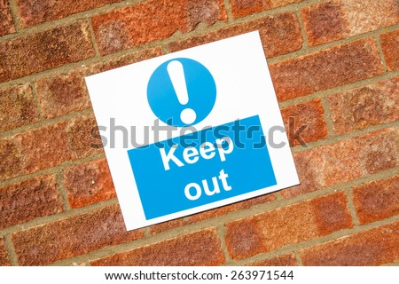 """Keep out "" danger sign on a brick wall background - stock photo"