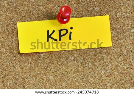 Key performance indicator (KPI) word on notepaper with brown cork background - stock photo