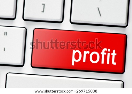 Keyboard with red button profit. Computer white keyboard with red button profit - stock photo