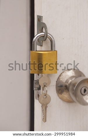 Keys in a door - stock photo