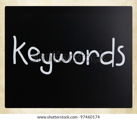 """Keywords"" handwritten with white chalk on a blackboard - stock photo"