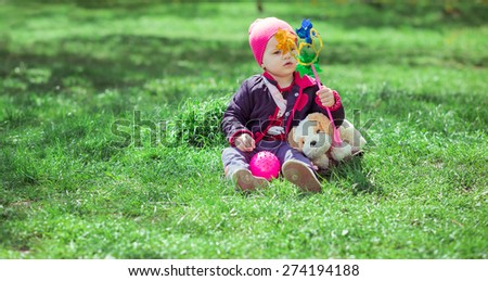 Kid playing in the grass city park - stock photo