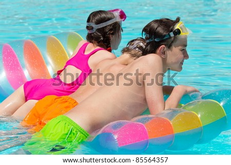 Kids on a pool float - stock photo