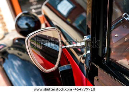 Kiev, Ukraine- July 16, 2016: Vintage car parts and elements. Glossy steel mirror. Selective focus. Little of DOF