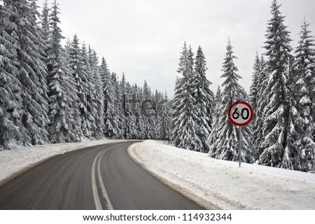 60 kilometers per hour speed limit sign on the serpentine road in Tatra Mountains - stock photo