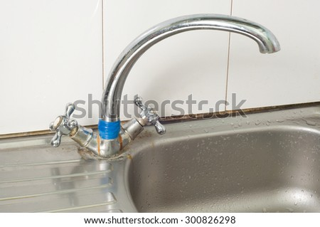 kitchen faucet old rusty - stock photo