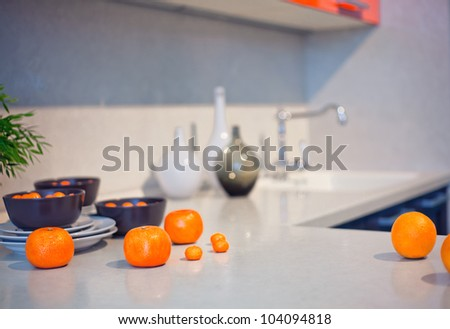 kitchen interior with fruits and dishes  on  countertop (beautiful Depth Of Field effect) - stock photo