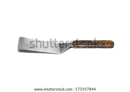 kitchen  trowel stainless  on a white background - stock photo