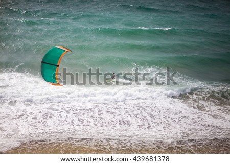 Kite surfing on a sunny day, kite surfer in action  - stock photo