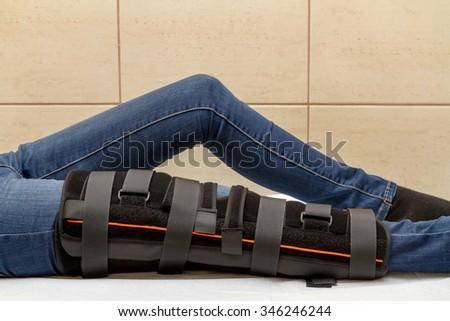 knee orthosis - stock photo