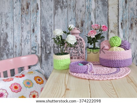 Knitted Decor Ideas for home.Crochet Baskets,Doilies,Pillow - stock photo