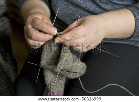 Knitting with hand.